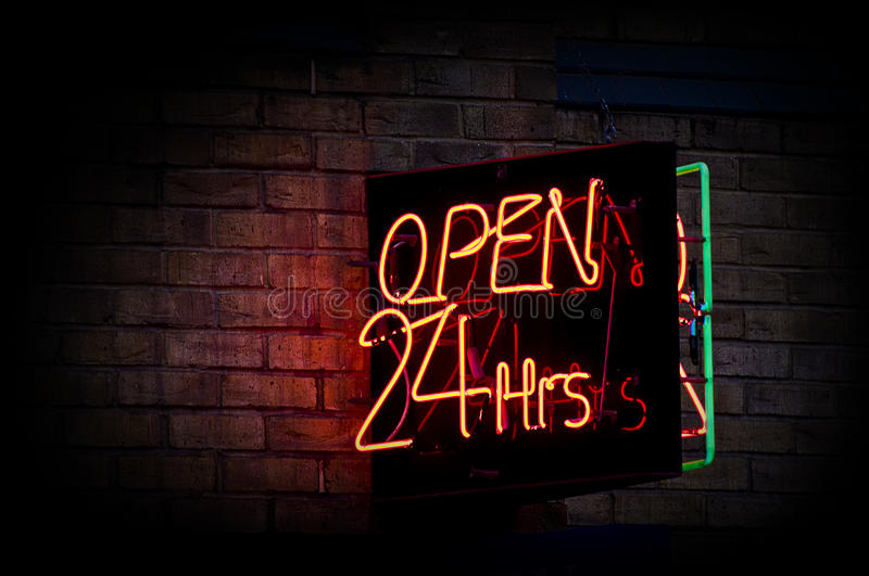 Open 24 hours. Neon sign displaying open 24 hours stock photo