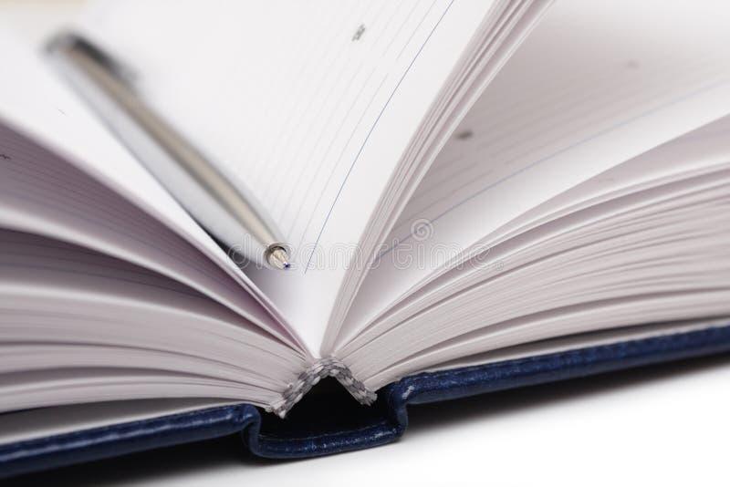 Open agenda met pen. stock afbeelding