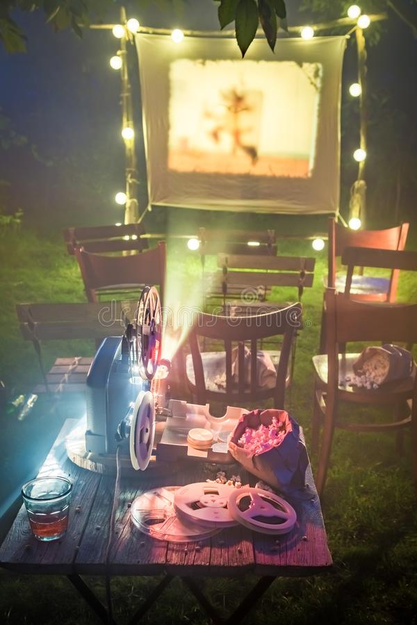 Open-air cinema with old analog films in the evening. Session in outside royalty free stock photos