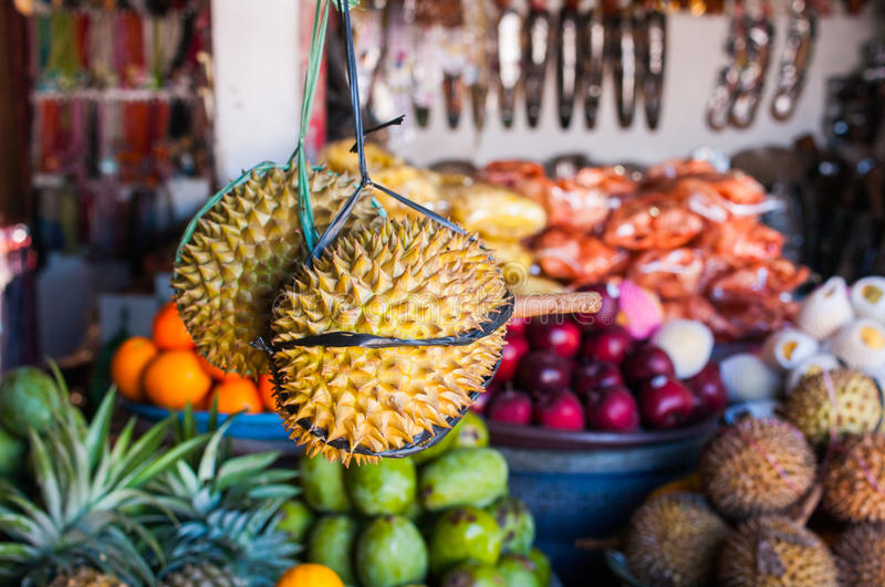 Open air fruit market in the village. Durians for sale in Bali Indonesia stock photos