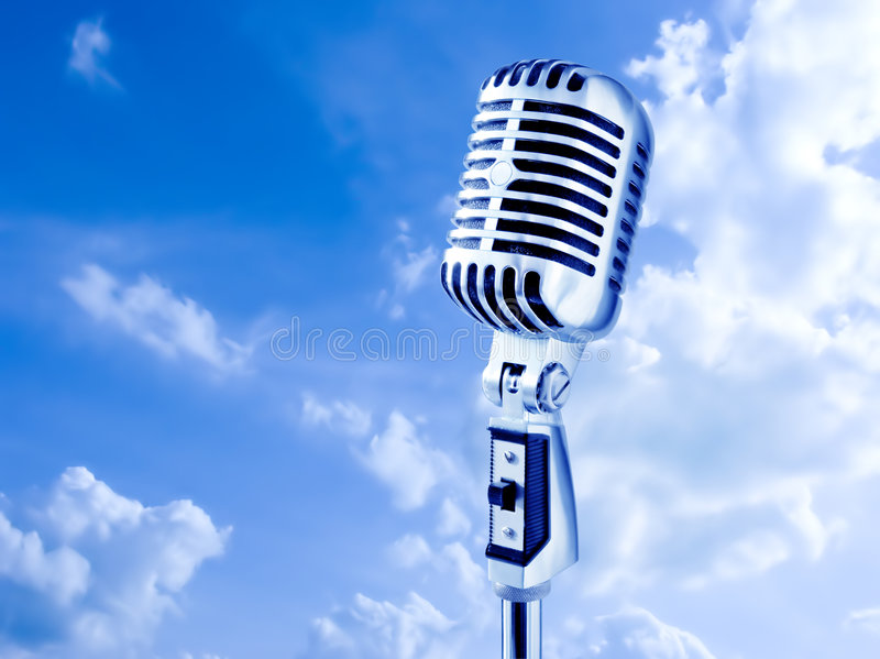 Open Air Mike. Retro Microphone Over Blue Sky
