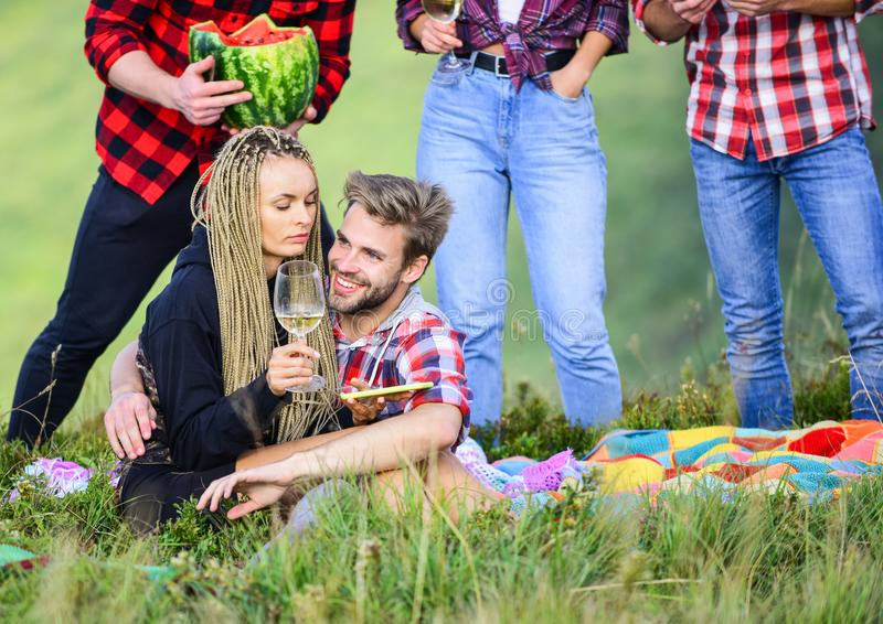 Open air party. Group friends summer picnic. Friends enjoy vacation. People eating food drink alcohol. Youth having fun stock image