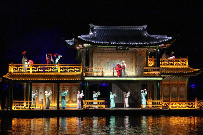 Open air performance and light show in West Lake, China royalty free stock photo