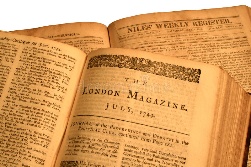 Open Antique Books. Two opened vintage books of containing hard bound volumes of long out-of-business periodicals royalty free stock photo