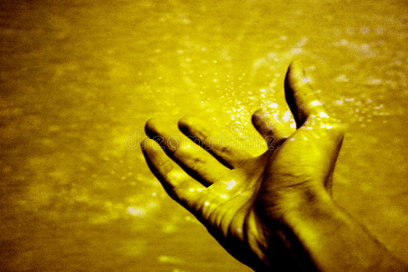 Open arm. Hand wide open, receiving miracle. concept for faith, healing, miracle, religious, etc. Grain & texture added for effect stock image