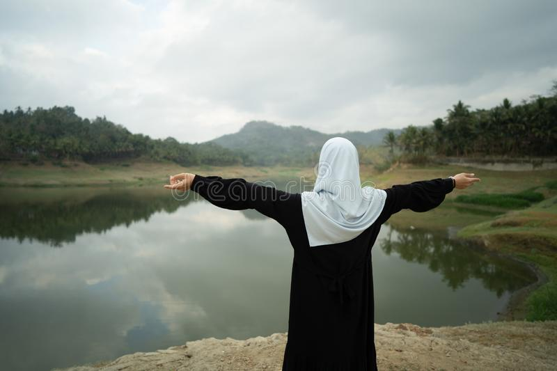 Open arm muslim woman outdoor royalty free stock image