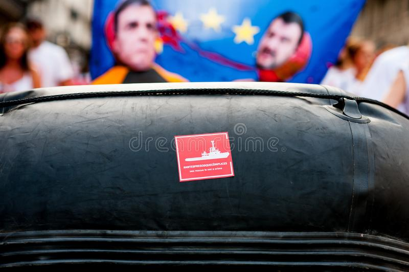 Proactiva open arms ngo sticker on rubber dinghy boat during public protest against italian far right politics and politicians stock images