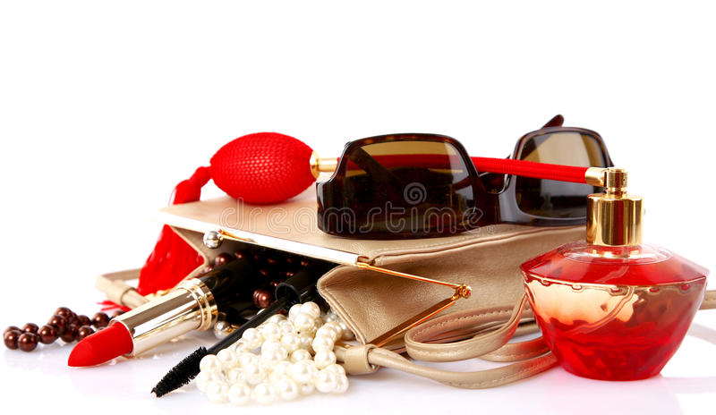 Open bag with female cosmetic snd accessories royalty free stock photography