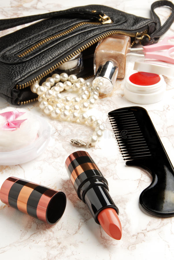 Open bag with female cosmetic snd accessories royalty free stock images