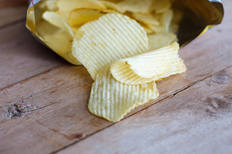 Open bag with potato chips royalty free stock photography