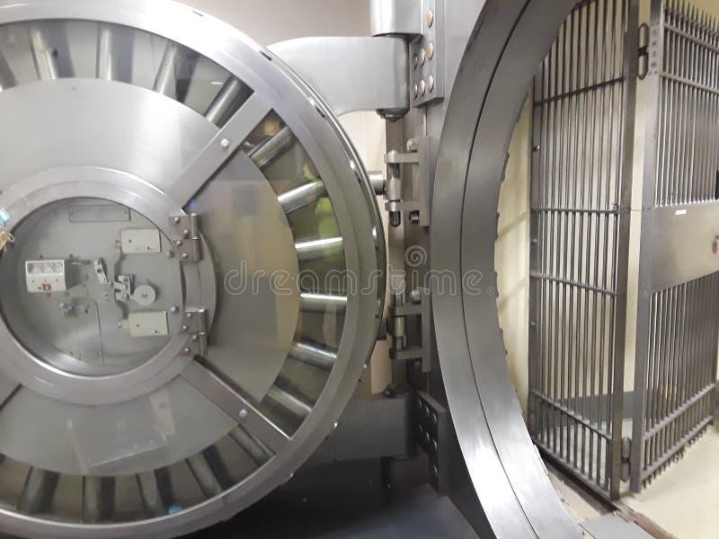 Open Bank vault. The massive steel door of a bank vault stock images