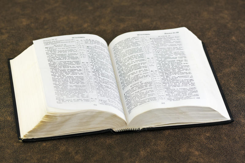 Open Bible. Rests on a brown fabric stock images