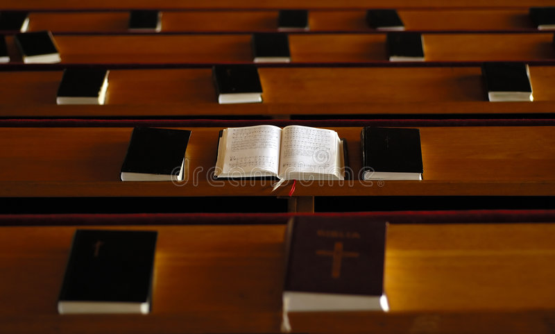 Open bible in the church stock images