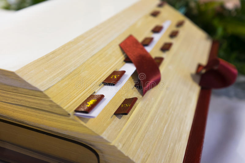 Open Bible in Church. Close up. Open Bible on the altar in catholic church. Detail. Shallow DOF royalty free stock image