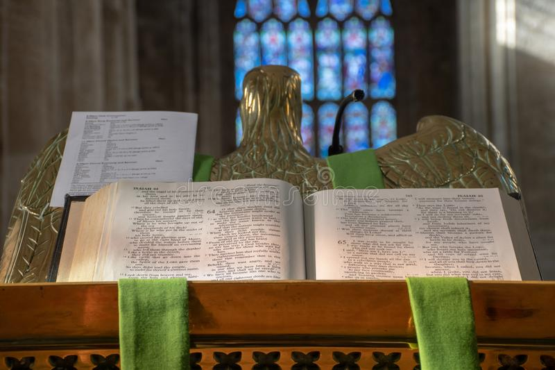 Open bible from grand pulpit in church. Open bible from grand pulpit in large church stock image