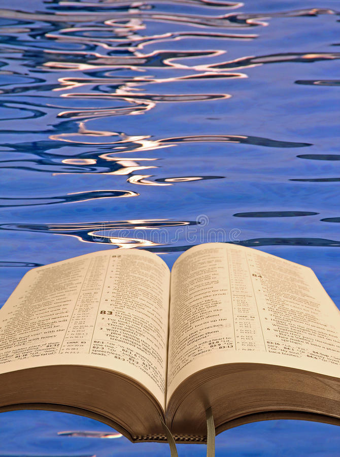 Open bible water ripples stock photo