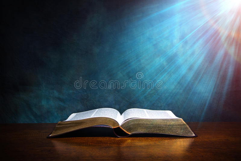 Open Bible on a wood table royalty free stock photos