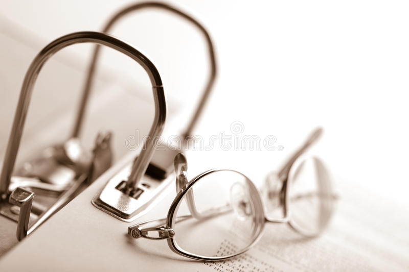 Open binder and glasses over document stock photography