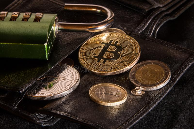 Open bitcoin and ethereum wallet. With combination lock stock image