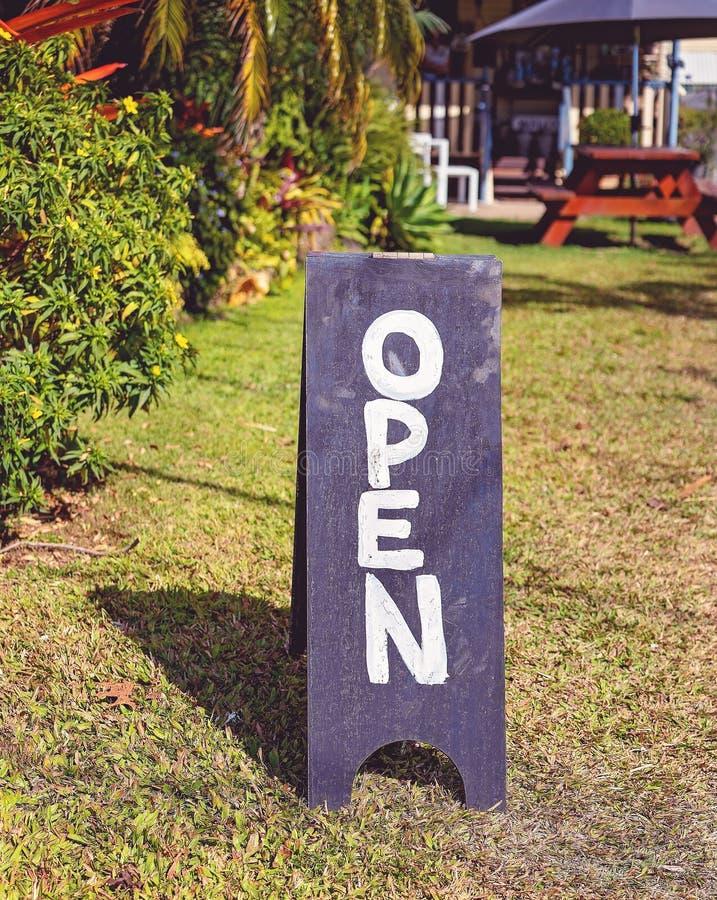 Open Blackboard Sign In Country Cafe Garden royalty free stock photos