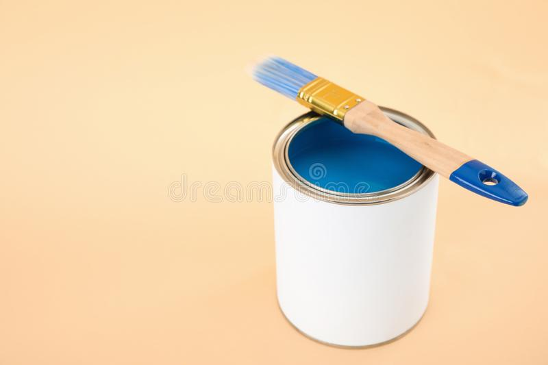 Open blank can of paint with brush. Space for text. Open blank can of paint with brush on color background. Space for text stock photo