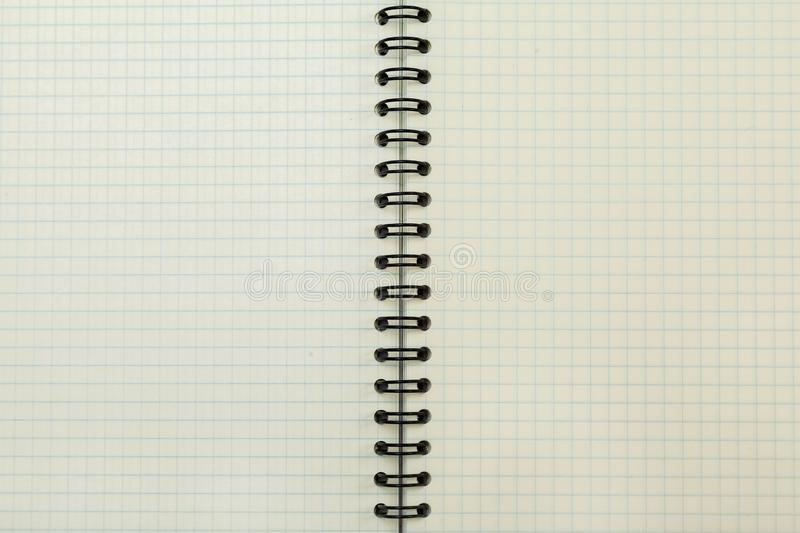 An open blank notebook, pages in a cage. Vintage toned photo. Copy space stock photo