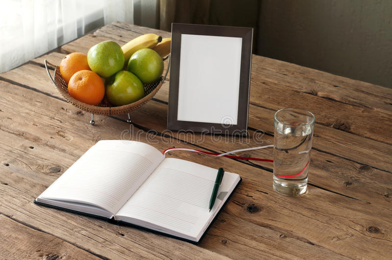 Open blank notebook on a wooden table royalty free stock photo