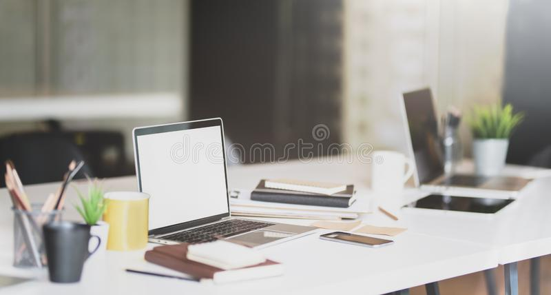 Open blank screen laptop and office supplies royalty free stock image