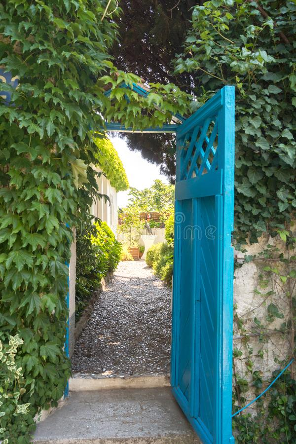 Open the blue door. Gursuf, Crimea - June 28, 2018: Open the blue door stock photography