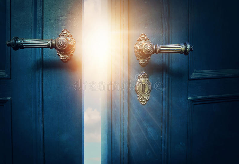 Open blue door. And sunshine royalty free stock images