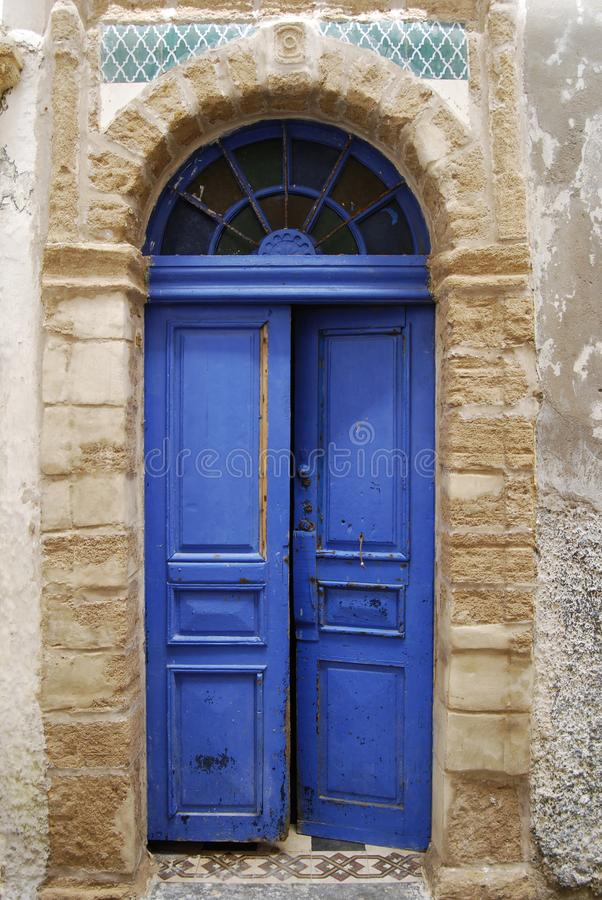 Open blue shabby door. In medina, Essaouira, Morocco royalty free stock photo