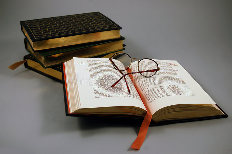 Open Book. Open leather book with glasses royalty free stock images