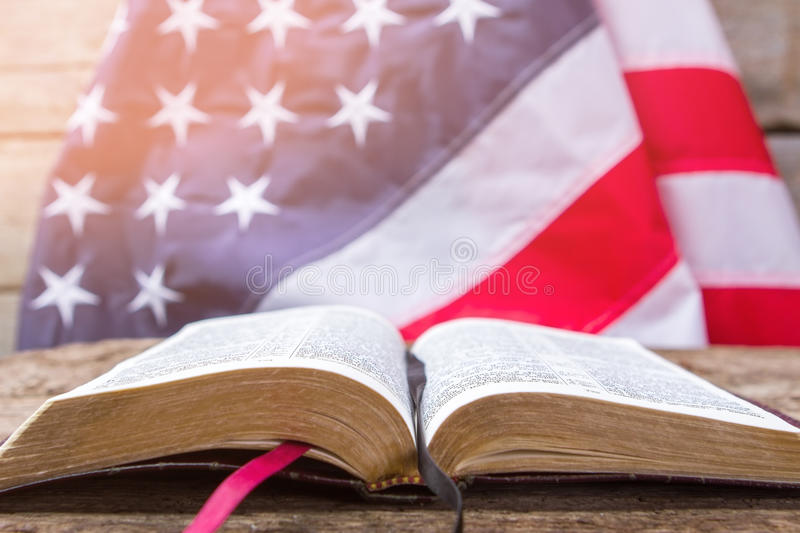 Open book and american flag. Open book on wooden surface. Value your independence. Freedom for every man stock photo