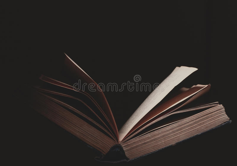 Open book on the black background stock photography