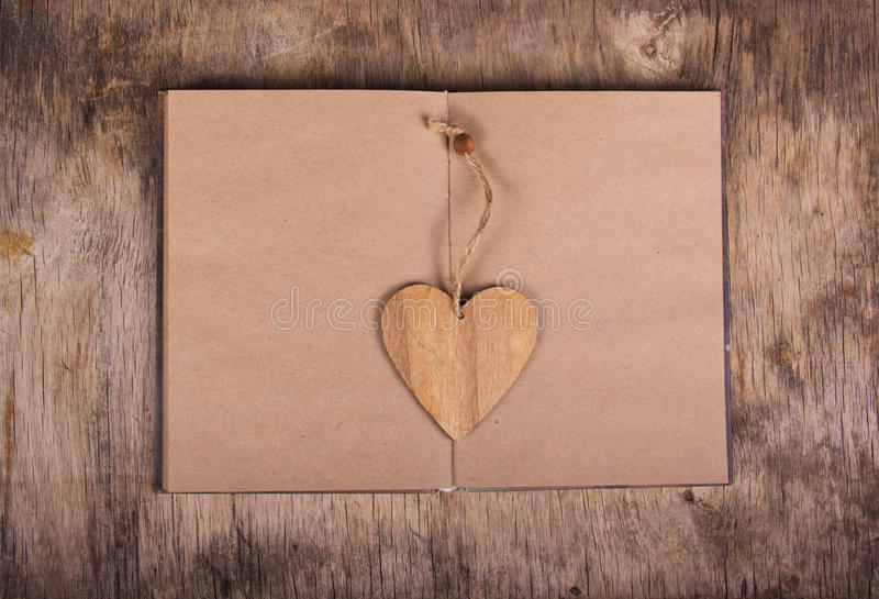 Open book with blank pages and a bookmark in the form of heart. Notebook made from recycled paper and valentine. Personal diary. stock image
