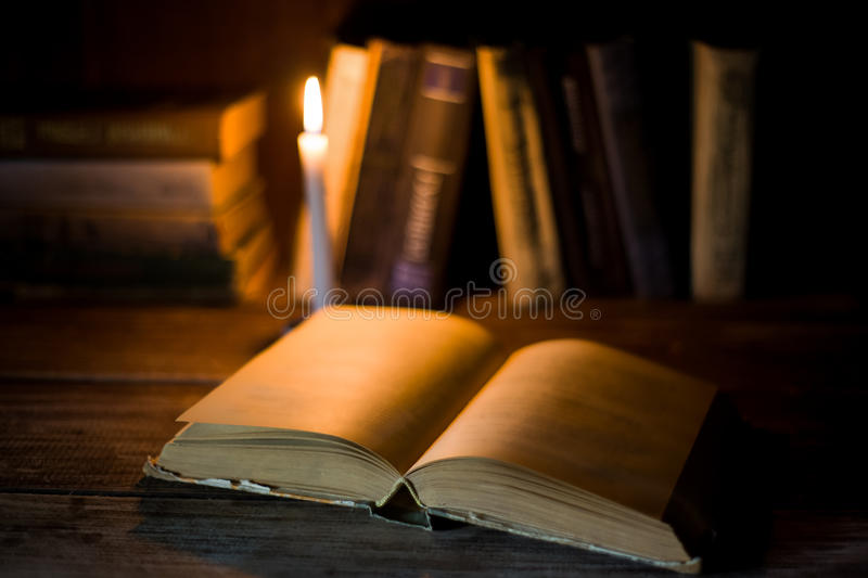 An open book with blank pages lies on a wooden table. stock photography