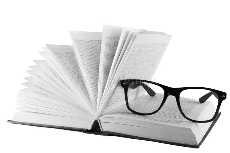 Open book bound in leather and glasses royalty free stock images