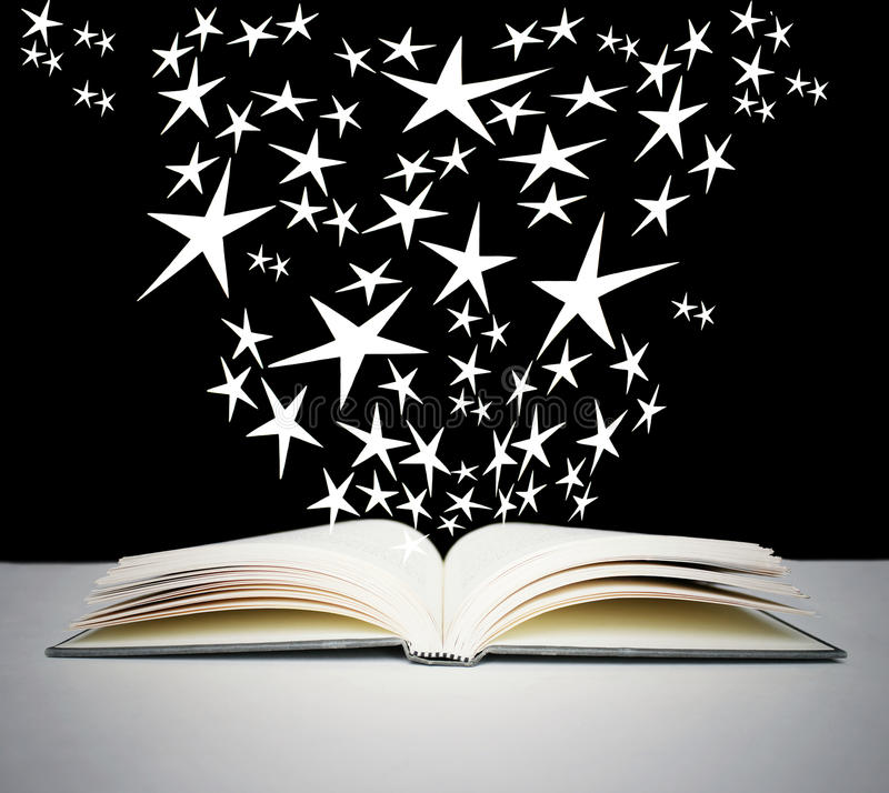 Open book and bright stars royalty free stock photos