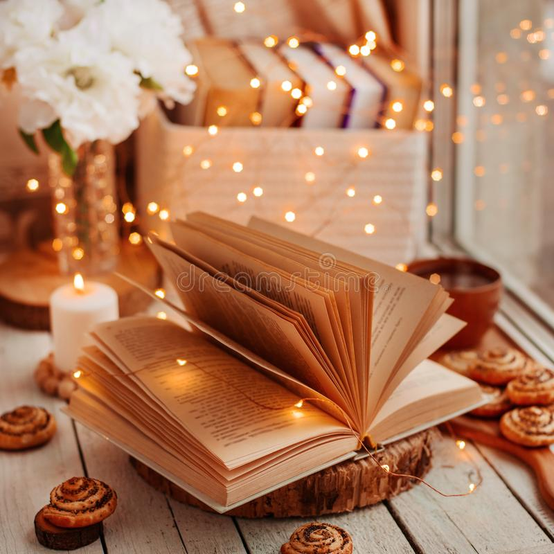 Open book with lights stock photo