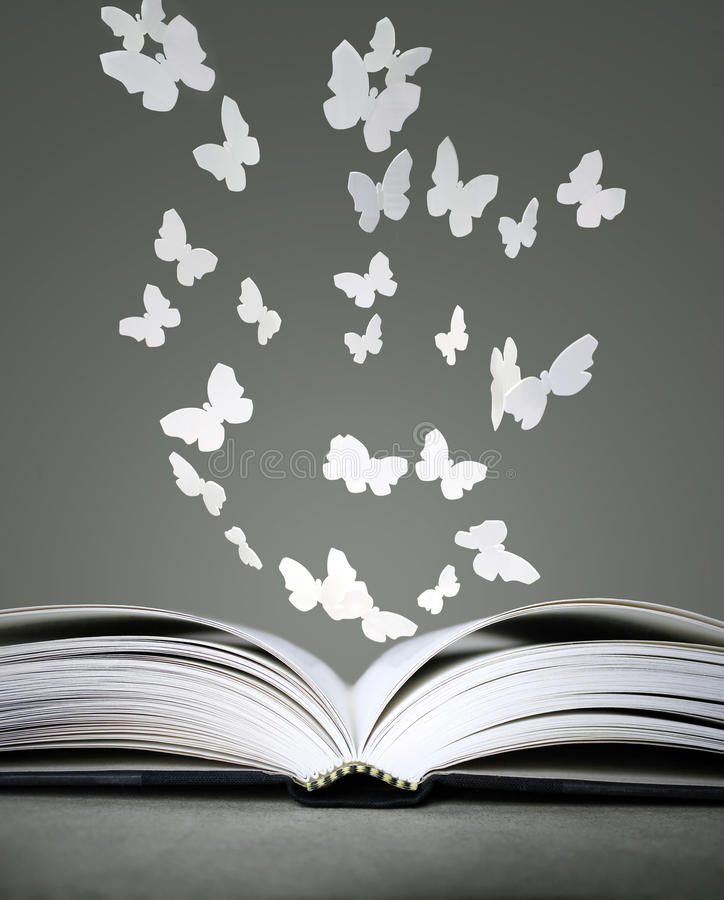 Open book and butterflies stock image