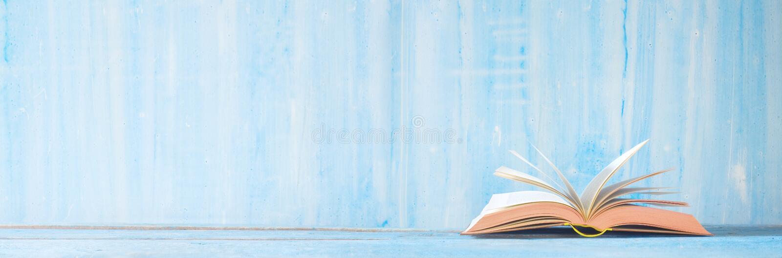 Open book, close up on blue grungy background,reading, education, literature,learning, good copy space royalty free stock photos