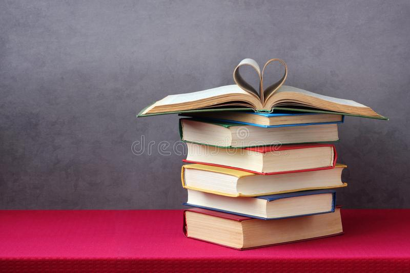 Open book with curled leaves in the shape of a heart. royalty free stock photo