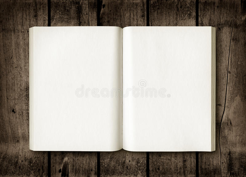 Open book on a dark wood table stock image