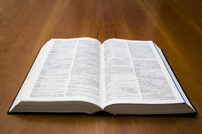 Open Book dictionary. Open book on a wood table stock images