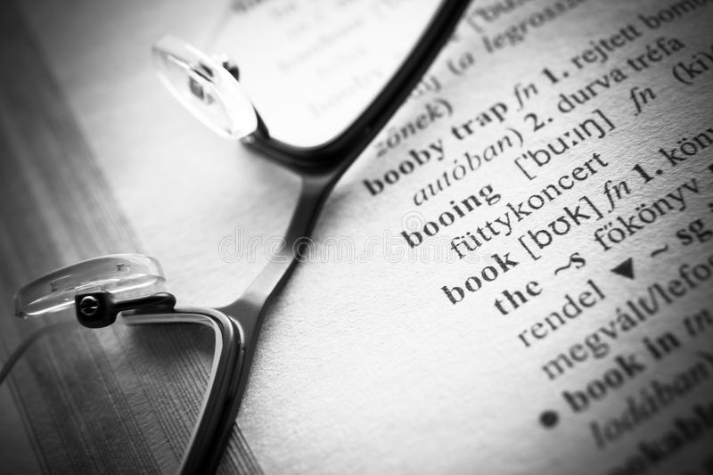 Open book Dictionary letters, close up. An open book Dictionary letters, close up royalty free stock image