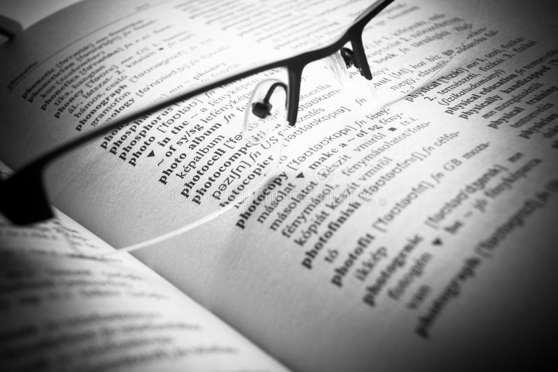 Open book Dictionary letters, close up. An open book Dictionary letters, close up stock photos