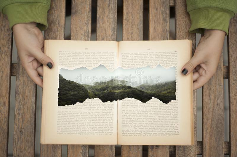 Open book with a drawn mountain stock images