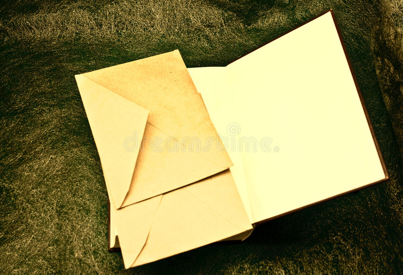 Open book and envelopes stock image