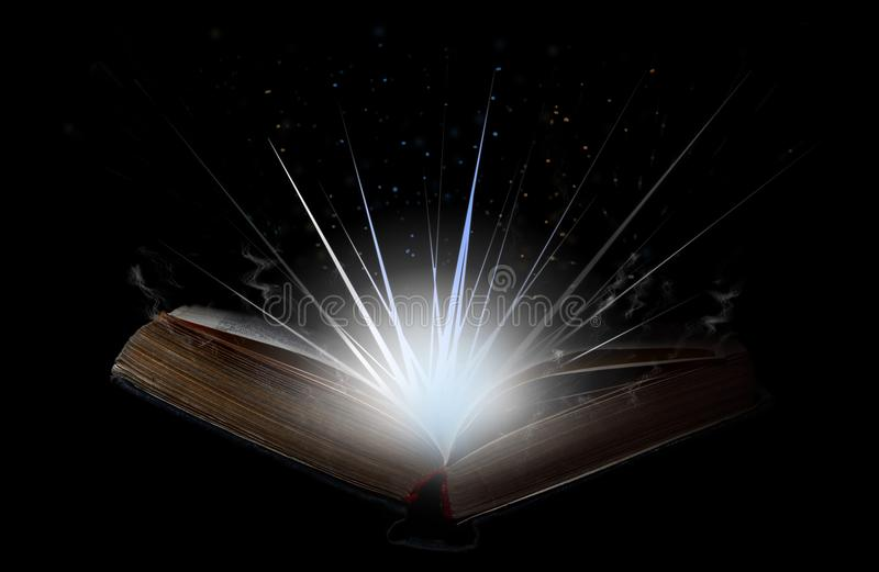 Open book with flash of light, magical smoke and glitter in the stock photography
