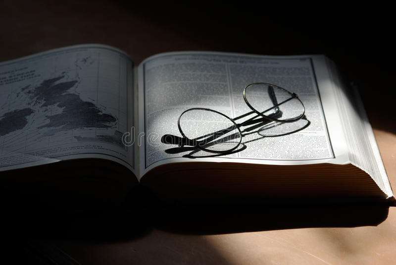 Open book with glasses royalty free stock photos